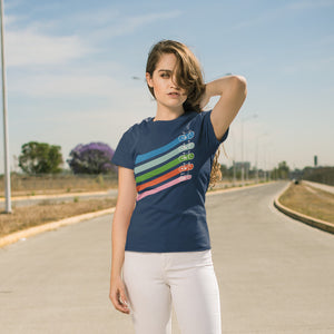 Woman wearing a navy cotton crewneck t-shirt of five retro coloured diagonal stripes leading to different styles of bikes