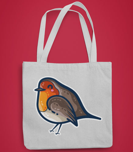A grey tote bag lying flat against a red background with the design of a kawaii cute robin bird facing to the left in the center of the bag