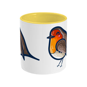 Two toned yellow and white ceramic mug seen from the side with a bit of the robin design visible on either edge