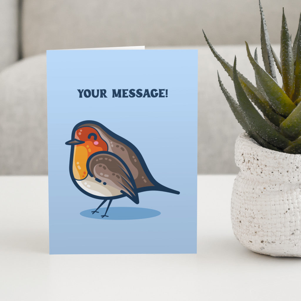 A kawaii cute robin bird with the words your message above in dark blue capital letters on a blue card standing on a white table next to a plant in a pot