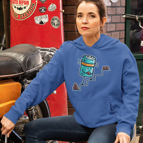 A woman sitting in a garage wearing a royal blue colour hoodie with the neck cords tucked in and a design of a kawaii cute cylindrical battery sweating and struggling to lift positive charge from the bottom to the top of some steps