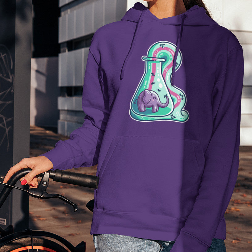 Torso of a woman wearing a purple hoodie with a design on its chest of a conicle flask with a purple elephant inside and green foam coming out and down with a pink stripe along the middle of it with small molecules represented in the foam