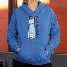 Load image into Gallery viewer, Torso of a woman wearing a royal blue colour hoodie with her hands in the front pouch and neck cords tucked away with a design on the chest of a tall corked glass vessel of liquid with a kawaii cute molar tooth in it and the words molar concentration running along the length of the glass vessel written in black