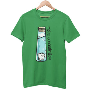 A green unisex crewneck t-shirt on a wooden hanger with a design on its chest of a tall glass vessel of blue liquid with a molar tooth in it and the words molar concentration written along the long side