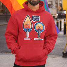 Load image into Gallery viewer, Torso of a bearded man wearing a red hoodie with his hands in the front pouch and the neck cords tucked in with a design on the chest of two kawaii cute matches in flame, one pointed with the word gravity beneath and one circular with the word microgravity beneath and a speech bubble between them saying physics is lit!