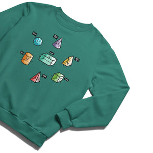 A jade green sweatshirt lying diagnonally flat with a design on its chest of colourful 3D shapes with faces and speech bubbles stating the equation for working out their volume.