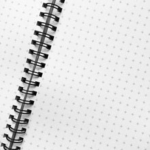 Load image into Gallery viewer, A close up picture of the grid graph paper option, showing the spiral wire binding and little crosses covering the white paper