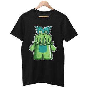 A black unisex crewneck t-shirt on a hanger with a design on its chest of a StarKid tickle-me-wiggly Black Friday musical green plush toy