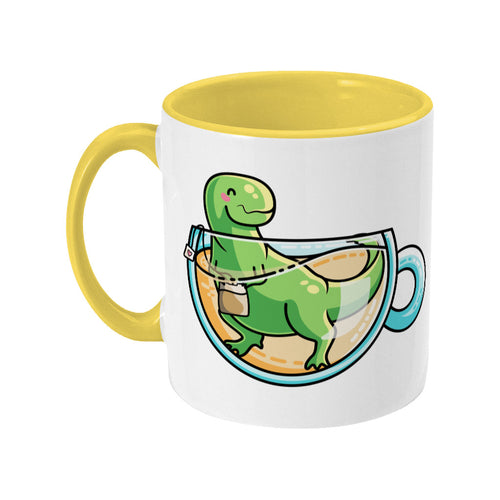 Green tyrannosaurus rex dinosaur in a glass teacup design on a two toned yellow and white ceramic mug, showing LHS