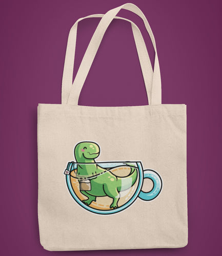 Green tyrannosaurus rex dinosaur in a glass teacup design on a recycled cotton and polyester tote bag