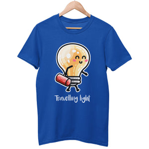 A royal blue unisex crewneck t-shirt on a hanger with a design on its chest of a kawaii cute lightbulb walking from left to right and facing right carrying a red bag above the words 'travelling light' written in white