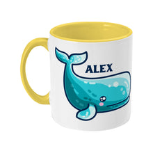 Load image into Gallery viewer, a cute sperm whale design shown on a white ceramic mug with a yellow handle on the left and personalised with the name Alex