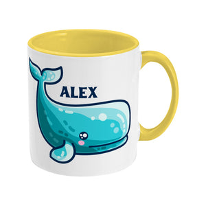 a cute sperm whale design shown on a white ceramic mug with a yellow handle on the right and personalised with the name Alex