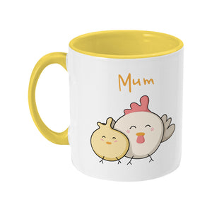 Kawaii cute hen and chick with word 'Mum' design on a two toned yellow and white ceramic mug, showing LHS