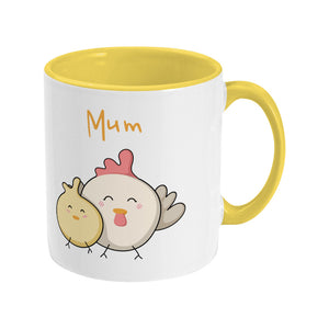 Kawaii cute hen and chick with word 'Mum' design on a two toned yellow and white ceramic mug, showing RHS