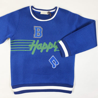 Stella McCartney Kids blue happy sweater with badges Second Season 10Y