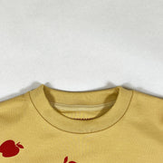 Tiny Cottons yellow long-sleeved french terry sweatshirt with red apple print
