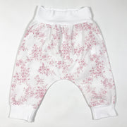 Snug white floral print trousers with wide elastic waistband 6M