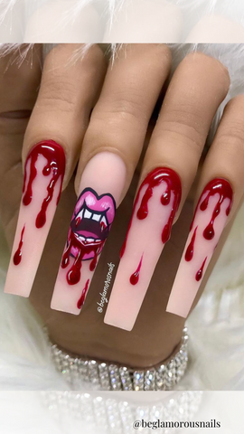 vampire fangs and blood on long acrylic nails