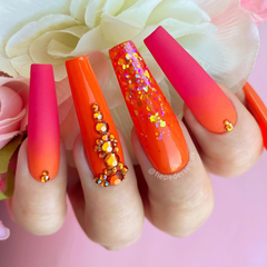 orange and red nails with rhinestones