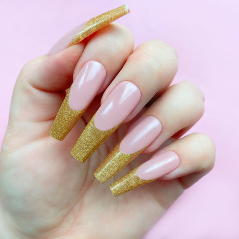 gold nail design with french tips and glitter