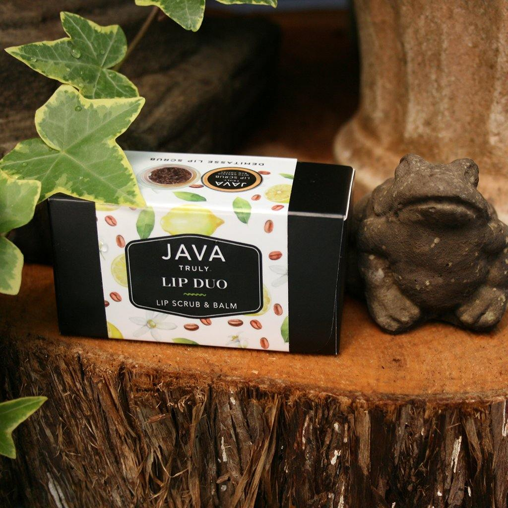 DEMITASSE LIP DUO sitting next to frog statue in greenhouse - Java Skin Care