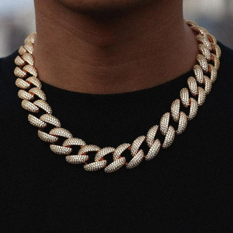 Are you looking for a cutting-edge deviation of the OG Cuban chain? The Curb Cuban chain has a really pronounced look; the links have flatter edges that make the whole piece appear more angular. While Curb links have a more rigid design, it's also important to note that the links are usually spaced out slightly more than the other major style of Cuban chains (i.e. Prong and Miami Cuban chains). The Curb Cuban chains tend to have a little more movement when they're worn because of the extra space between each link.
