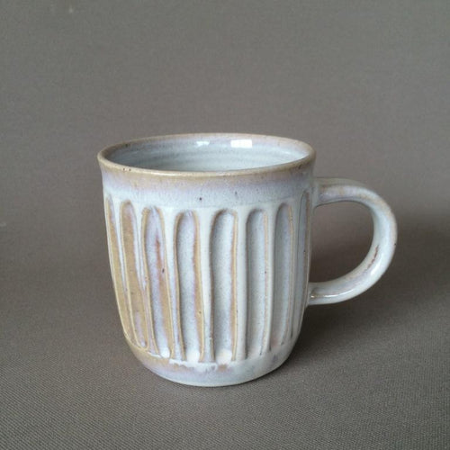 Vertical carved mugs