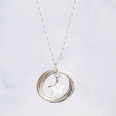 Sterling circles linked together to form one circle with a personalised star charm in the centre