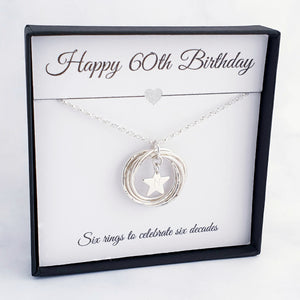 Sterling silver necklace with 6 textured circles, linked to form one circle, with a personalised star charm in the centre.