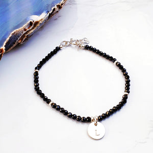 black beaded bracelet with an initial charm sterling silver
