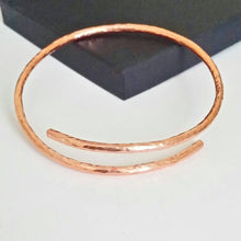Load image into Gallery viewer, Copper adjustable bangle, with a hammered texture design.  Bangle adjustable from 65mm to 75mm.