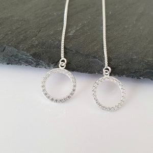 Sterling silver threader earrings with cubic zirconia circles suspended at the bottom