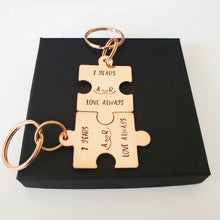 Load image into Gallery viewer, 2 Interlocking personalised copper puzzle piece keyring. Hand stamped 7 YEARS and LOVE ALWAYS. Option to add initials.