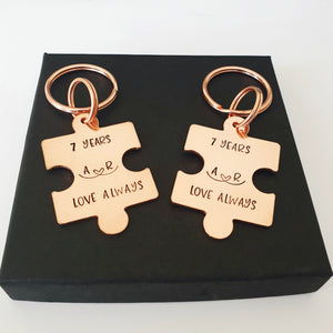 2 Interlocking personalised copper puzzle piece keyring. Hand stamped 7 YEARS and LOVE ALWAYS. Option to add initials.