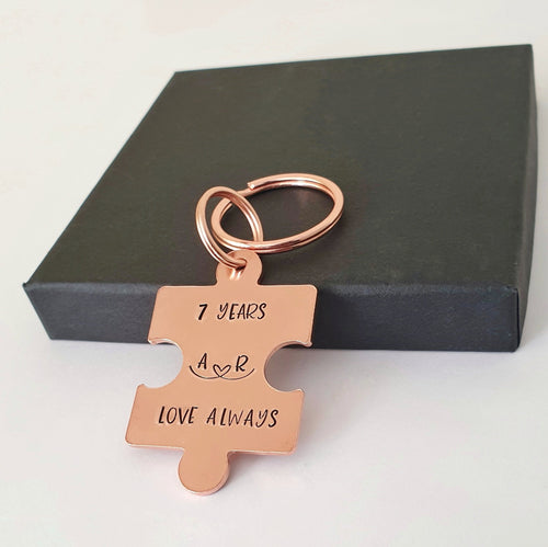 Personalised copper puzzle piece keyring. Hand stamped 7 YEARS and LOVE ALWAYS. Option to add initials.