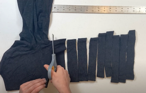 Cut your shirt into 1 inch strips