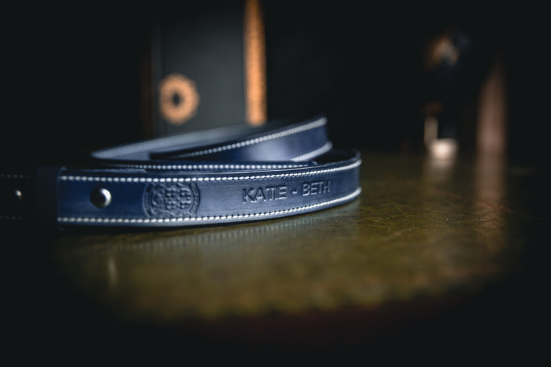 25mm ladies leather belt, blue with white stitching and coupland crest