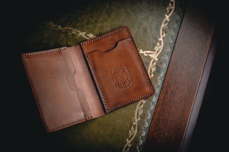 light brown mike leather wallet with coupland crest