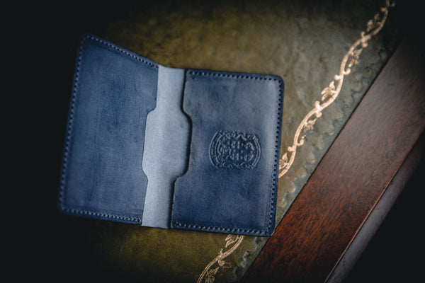 blue leather bi-fold business card wallet open with coupland crest