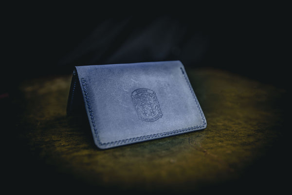 blue leather bi-fold business card wallet closed with coupland crest