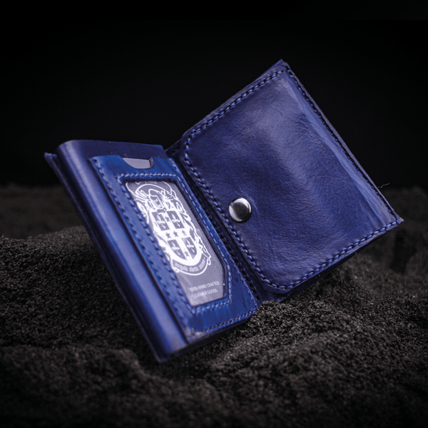 dark blue leather olly wallet open with coupland crest