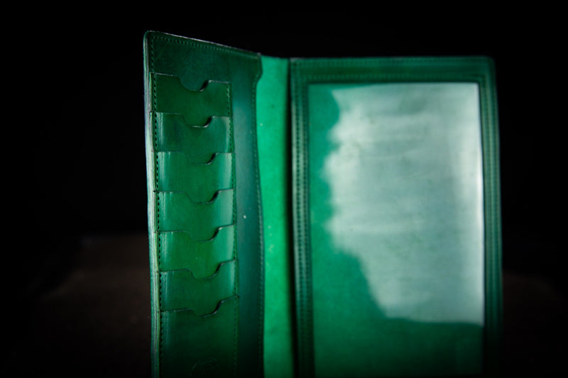 green leather firearms certificate and card holder close up