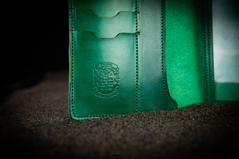 green leather firearms certificate and card holder close up of coupland crest