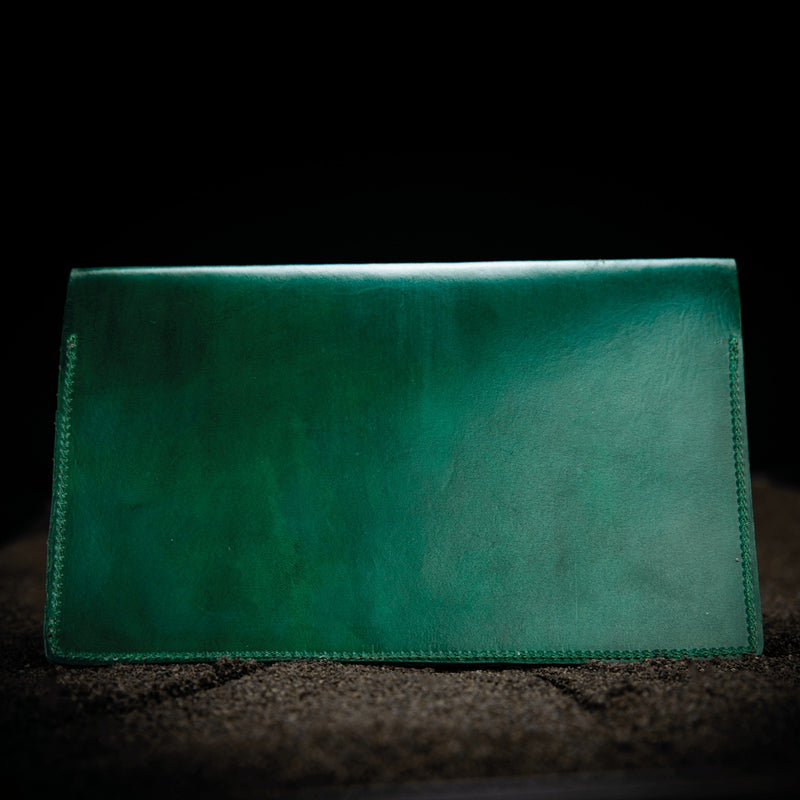 green leather firearms certificate and card holder closed