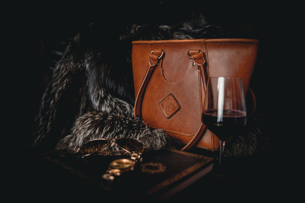 luxury ladies chestnut leather tote handbag with blanket and glass of wine