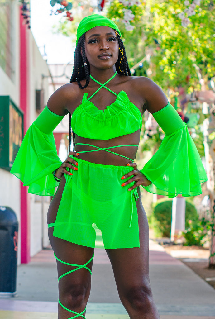 Model wearing: Divine Liberation Top  with Wrap Around Me Sexy Leg Wraps Tie Skirt in Neon Green