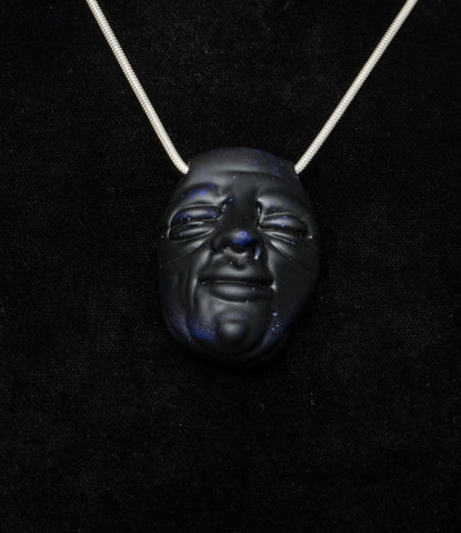 ETHAN WINDY FACE PENDANT