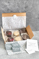 Box of mixed alfajores with dark chocolate, raspberry jam and walnuts and white chocolate, all filled with dulce de leche in sustainable compostablepackaging