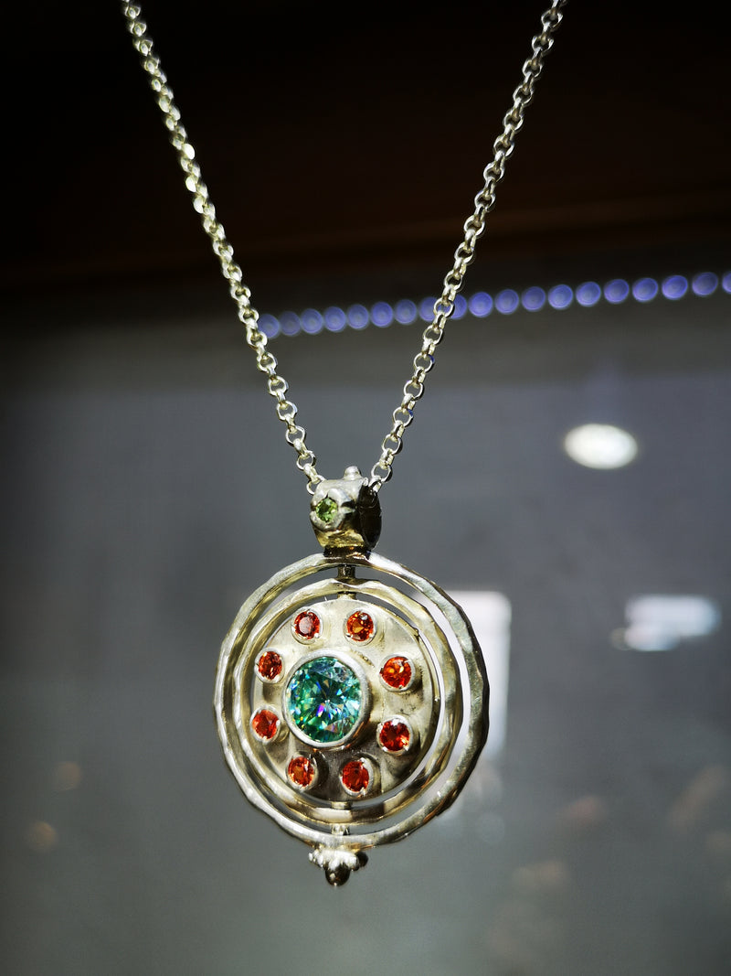 Moissanite and Sapphire Silver Spinning Pendant